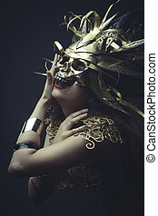 Jewelry, Girl in dress made of golden threads with golden...