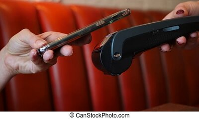 payment of the bill in the cafe from the smartphone through...