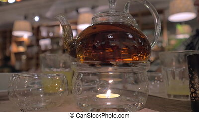 Glass teapot on the table in restaurant - Close-up shot of a...
