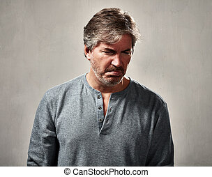 disappointed man - disappointed mature man over gray wall...