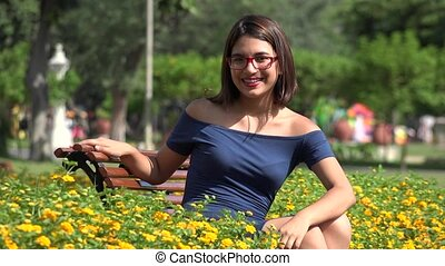 Happy Teen Girl With Eyeglasses In Park With Butterfly