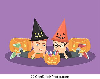 Caucasian boys staring at the pumpkin with candies -...