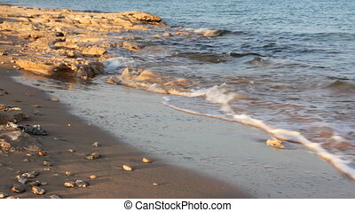 sea water waves and sand beach with stones