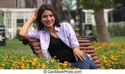 Happy Smiling Female Teen Wearing Braces On Park  Bench