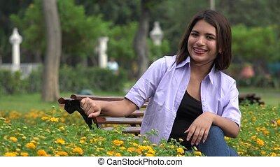 Happy Female Teen In Park Wearing Braces