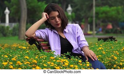 Unhappy Teen Girl Sitting Alone In Park