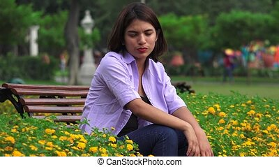 Unhappy Teen Girl Alone In Park