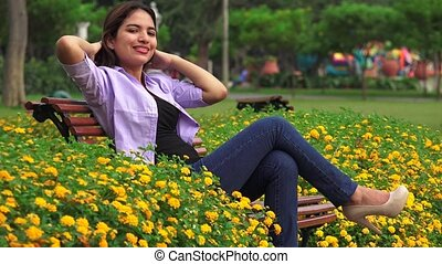Female Teen Sitting In Park Many Butterflies