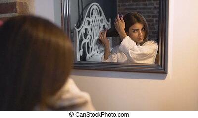 Beautiful Girl Brushes Hair - Beautiful caucasian girl...