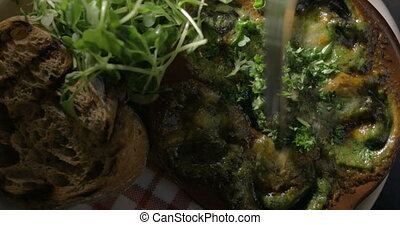 Having meal with escargot dish - Close-up shot of eating...