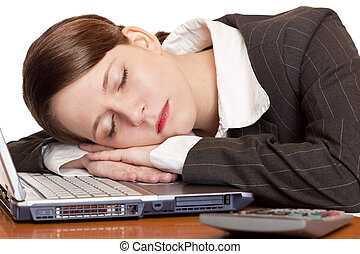 Tired overworked business woman sleeps in office on laptop...