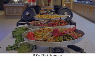 Concept of food, holiday. Buffet with stewed vegetables in the hotel restaurant.