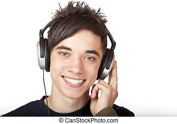 Male Teenager listening to music and smiles happy. Isolated...