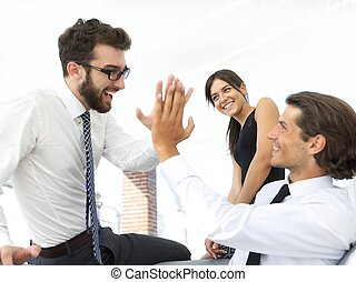business colleagues giving each other high five. concept of...