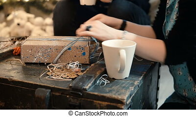 Close-up view of young couple sitting in evening at home and...