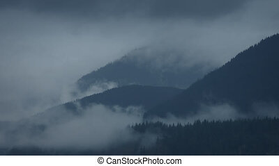 Mountain Wilderness In Cloud And Mist - Dramatic wild...