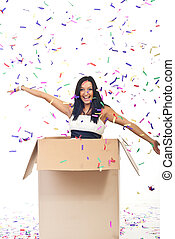 Happy woman with confetti out of the box with open hands and...