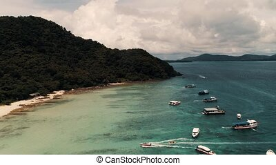 Thailand Coral Island Drone Shot Small sports boats, large...