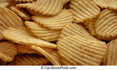 Ridge Cut Potato Chips - Ridge-cut potato chips closeup shot