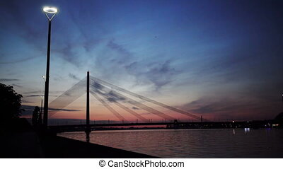 Summer sunset of suspension bridge in Riga, Latvia,