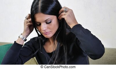 Attractive young man listening to music on headphones