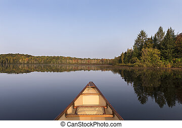 Canoe bow on a lake in late summer - Ontario, Canada - Canoe...