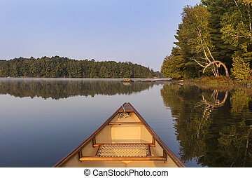 Canoe bow on a lake in late summer - Ontario, Canada
