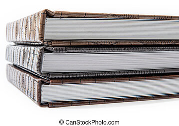 hardcover books lying on a white background - The pile of...