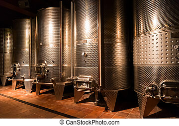 cellar with wine barrels - cellar with modern metal wine...