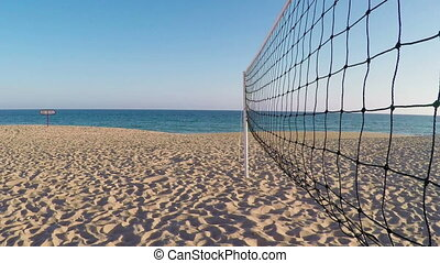 Volleyball net on beach in summer in Portimao. Portugal -...