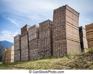 Exterior view of sawmill storage - View wood planks stacked...