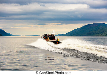 Tourists speedboating on a RIB boat, Loch Ness - Tourists...