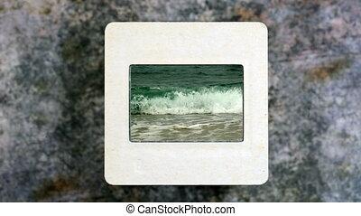 Sea waves on old vintage slide film