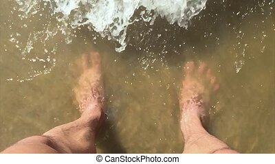 feet waves man of sea slow motion video. male tourist is...