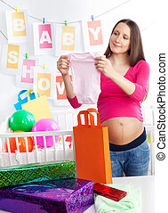 baby shower holding body - Pregnant woman at her baby shower...
