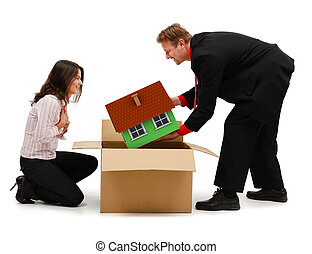 Business man unpacking a new house for wife or client -...