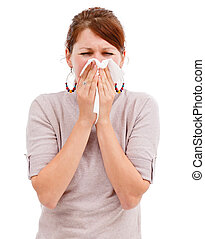 Young woman blowing her nose - Young allergic woman sneeze...