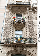 Balcony with decorated golden banisters in Prague