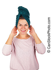 Smiling woman with towel on head - Smiling young woman after...