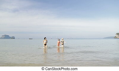 Girls Running From Water On Beach, Young Woman Group On Sea...