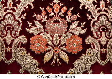 Crimson fabrics with golden pattern in the manner of...