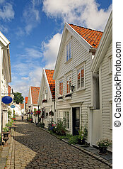 Old houses in Stavanger, Norway. - Street with white houses...
