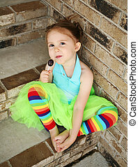Preschool girl with tutu and candy sucker - Portrait of a...