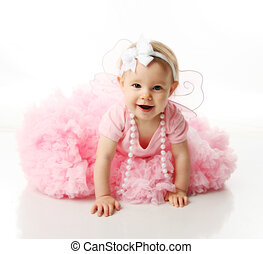 Baby girl wearing pettiskirt tutu and pearls - Portrait of a...