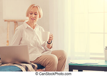 Nice senior woman resting at home - Pleasant time at home....