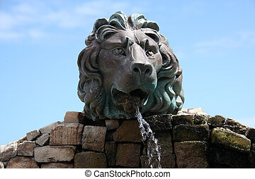 Lion water fountain. - Lion water fountain outdoors.