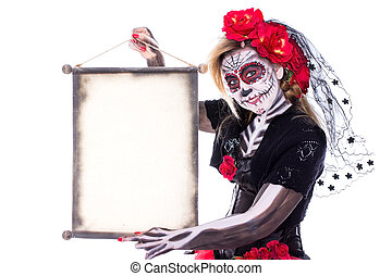Sugar Skull with scroll - A Sugar Skull holds a scroll in...