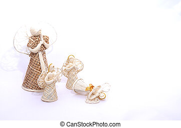 Fallen Angel - White Christmas straw angel ornament isolated...