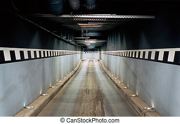 Access to an underground garage Long tunnel