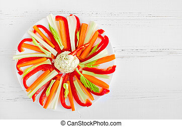 Colorful vegetable sticks in a plate with dip sauce -...